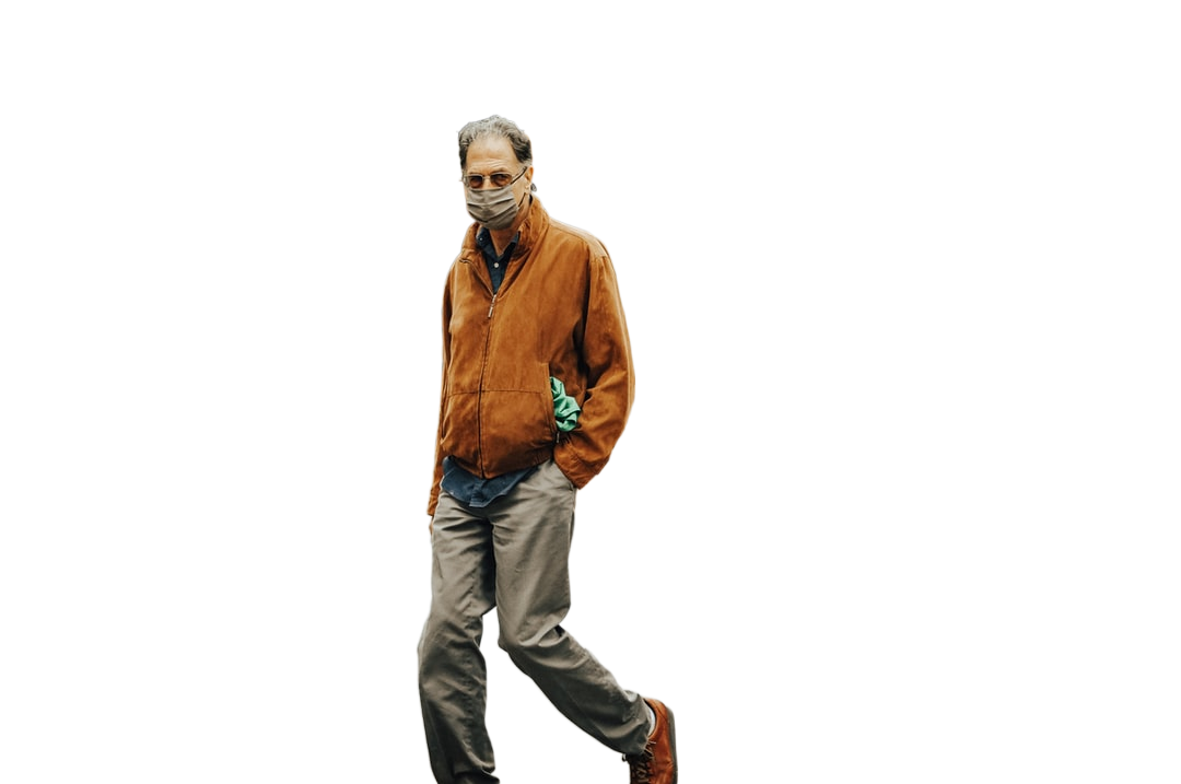 man in brown jacket and gray pants walking on street during daytime