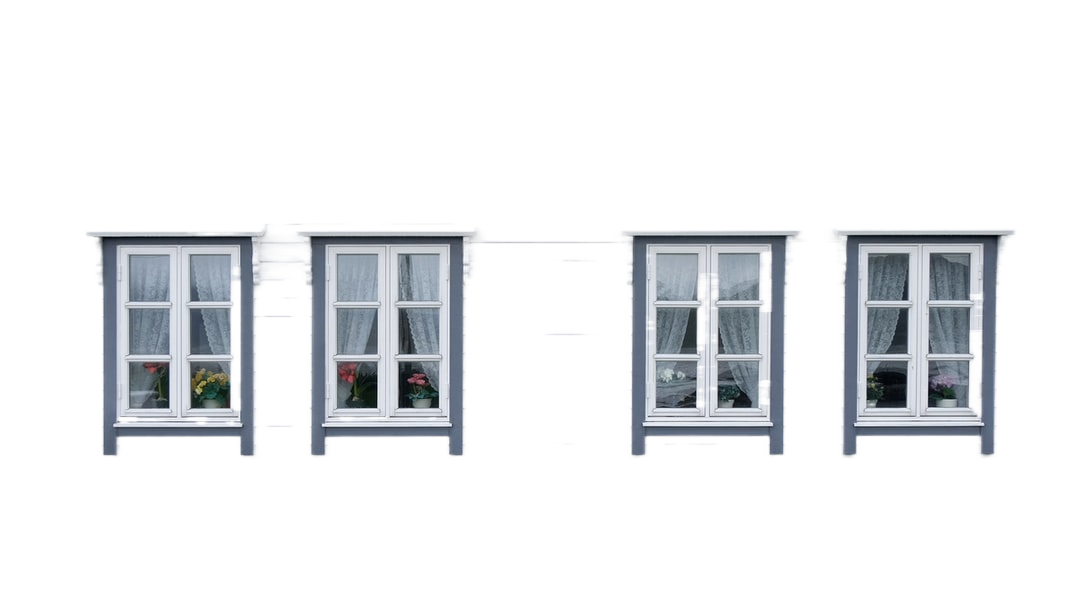 closed white and red house windows
