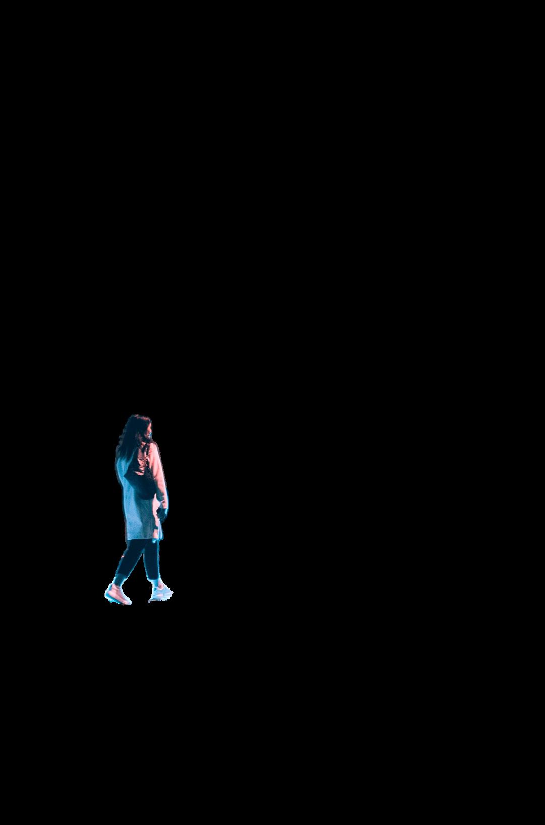 woman in white long sleeve shirt and black pants walking on sidewalk during daytime