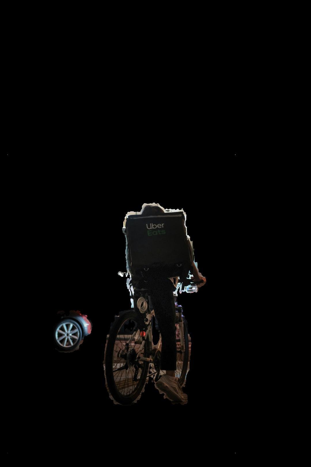 black bicycle parked beside black car