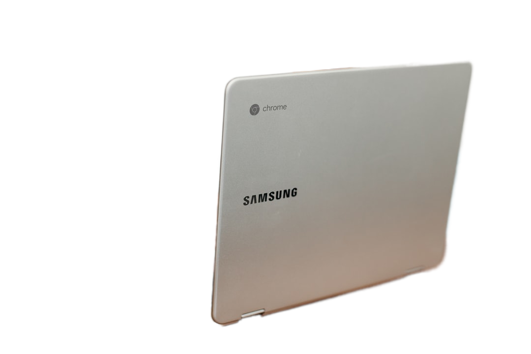 shallow focus photography of person using gray Samsung laptop