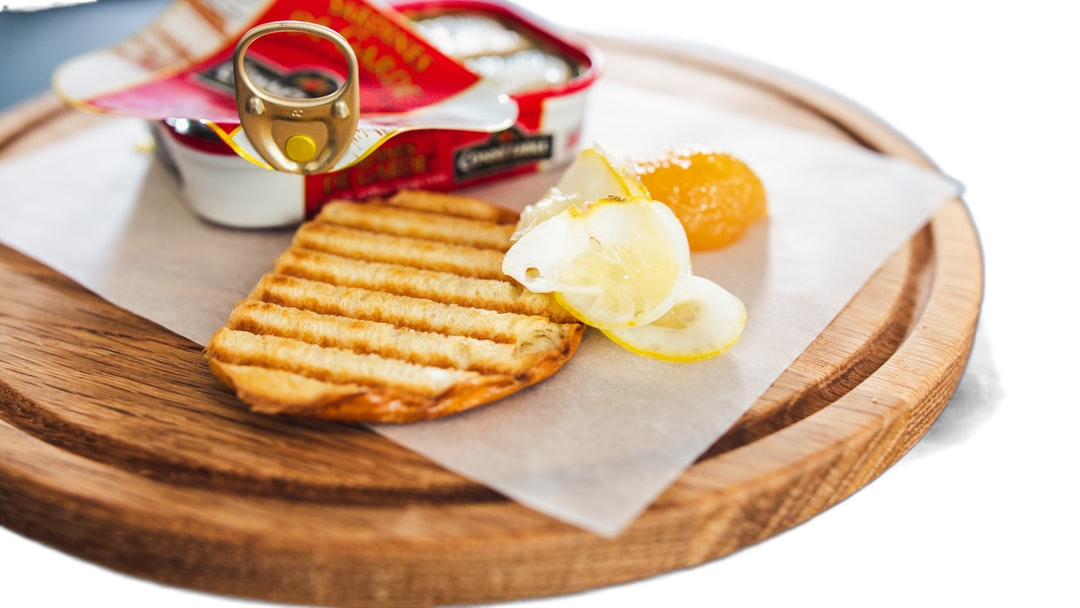 potato fries on brown wooden round plate