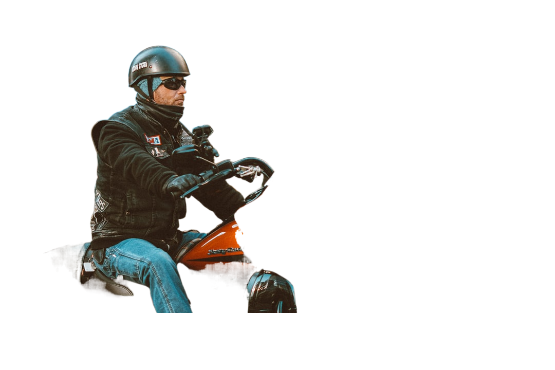 man in black leather jacket and blue denim jeans riding orange and black motorcycle