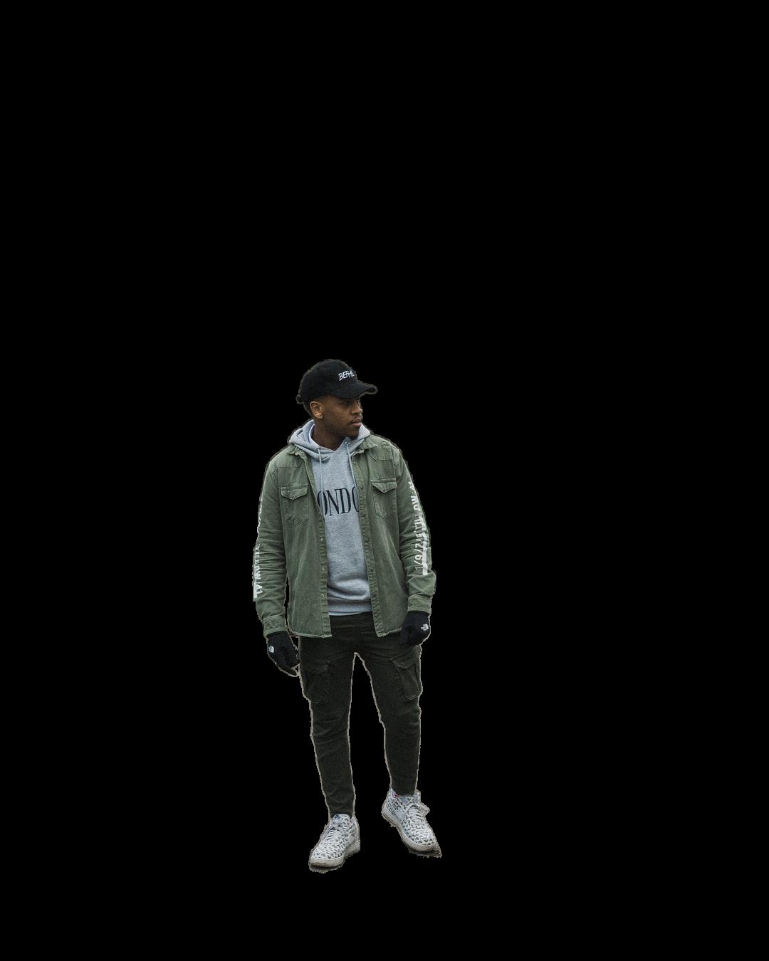man in gray jacket standing on bridge