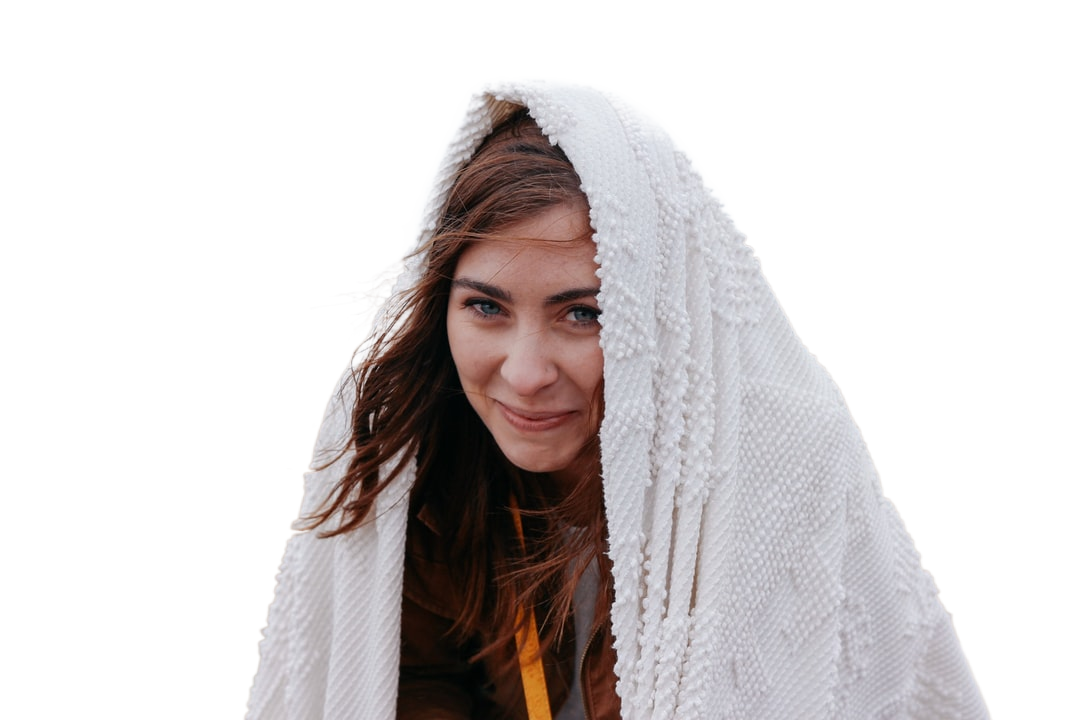 smiling woman wrapped with white headscarf