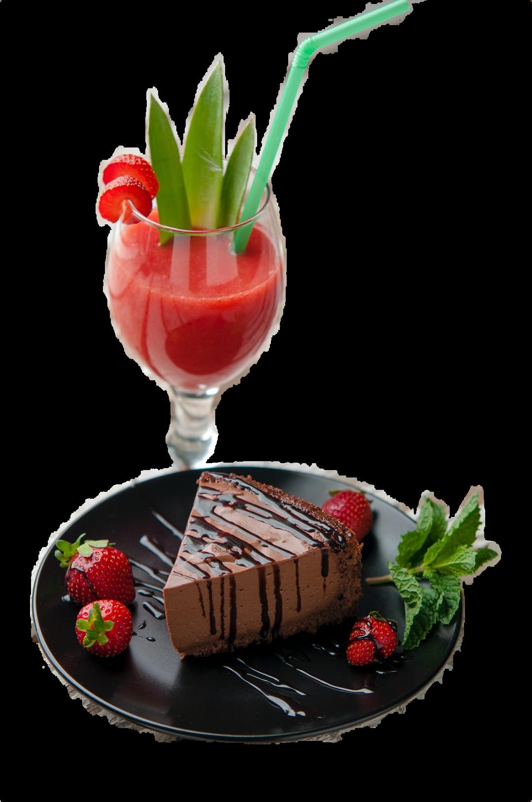 chocolate cake beside strawberries and wine glass
