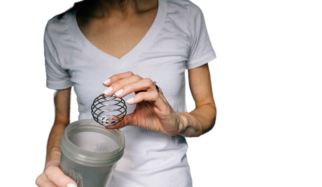 woman in white scoop neck shirt holding white ceramic mug