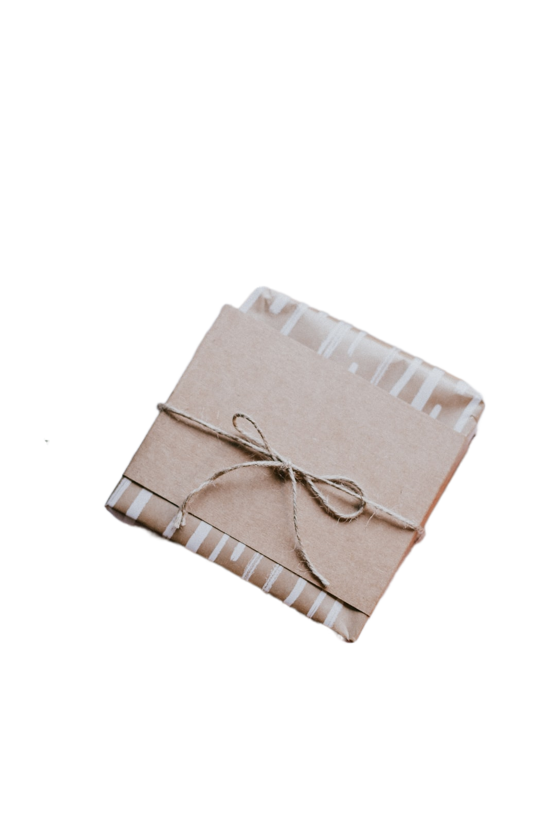 brown gift box on white and red checkered textile