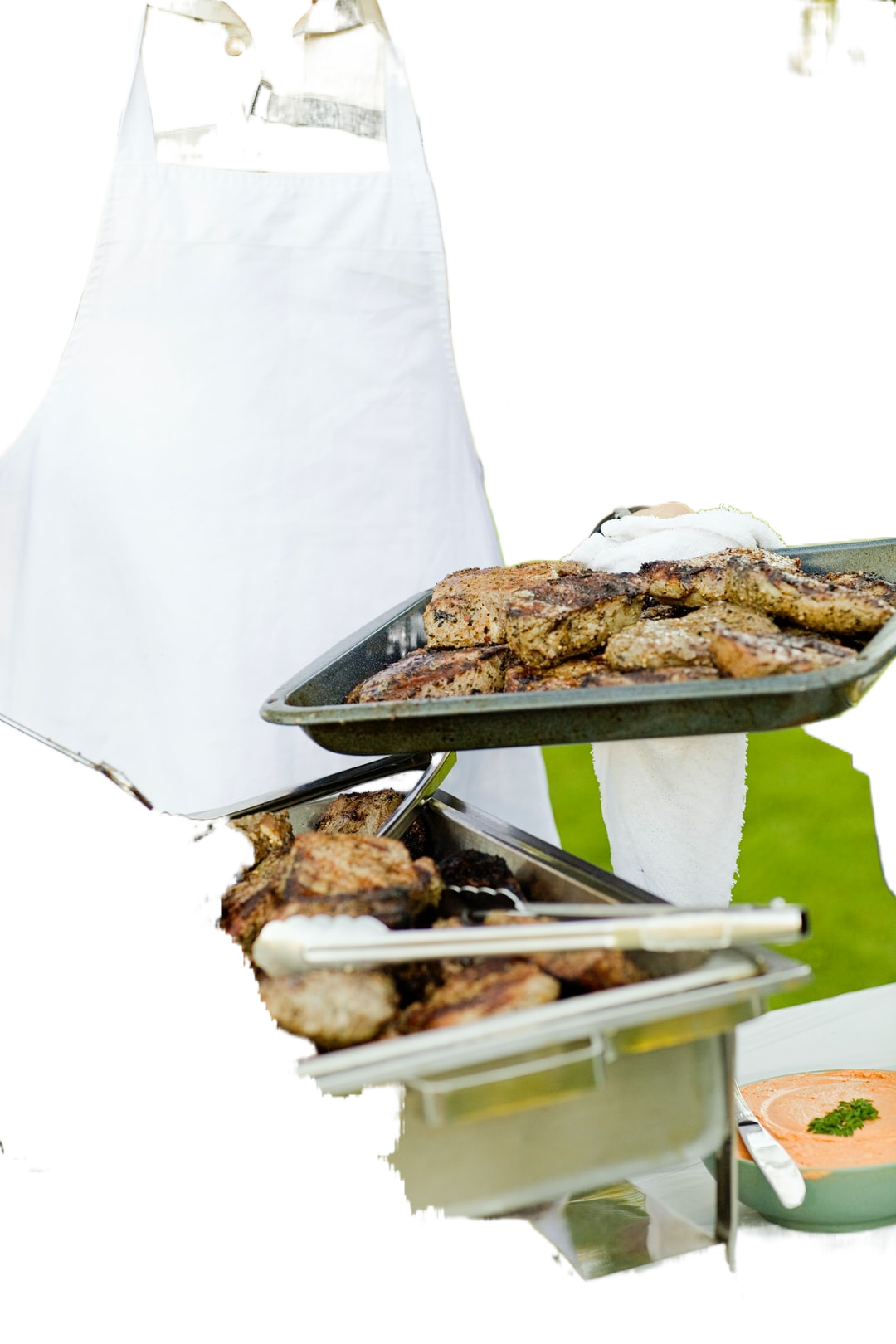 person holding tray filled with grilled meat