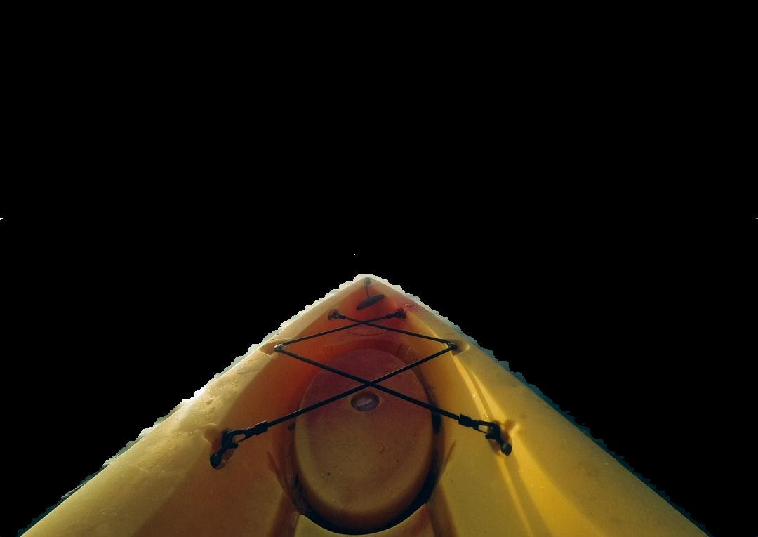 person riding yellow kayak during daytime