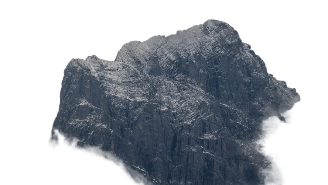 grey mountain under cloudy sky during daytime